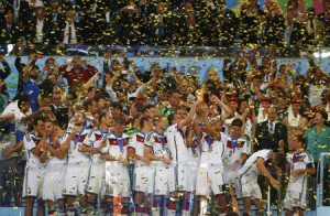 Germany's players lift the World Cup trophy as they celebrate their 2014 World Cup final win against Argentina at the Maracana stadium in Rio de Janeiro